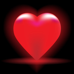 Bright red heart on a black background