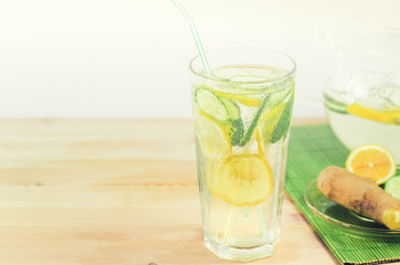Sassy diet water. Detox drink. Fresh cold water with lemon, ginger and cucumber. Picture with space for text or logo
