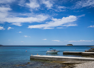 Yacht at pier on blue sea in Croatia