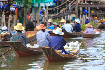 many of sellers making trading food and vegetable in floating market for tourist and people