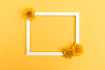 Picture frame with flowers on a yellow background