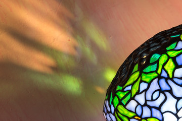 Tiffany style lamp and reflections. Diagonal close up.