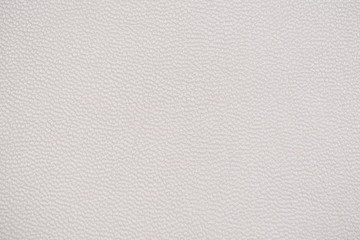 White leather texture as background.
