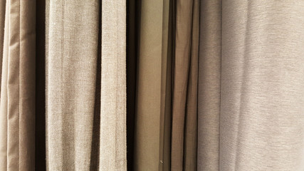 group of grey fabric roll selection / stock of grey fabric for fashion design business, raw material in garment manufacturing