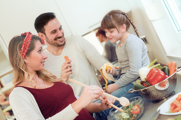 Family preparing breakfast in kitchen