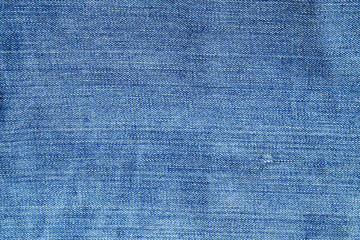Blue color weathered denim texture.