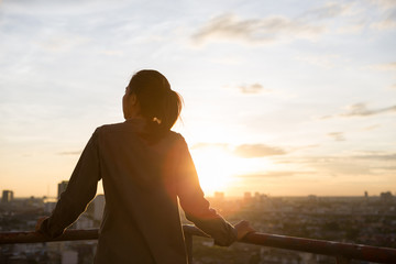 women see city view when sunset time