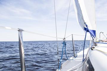 Sailboat sails on the sea