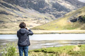 Glencoe / Scotland - May 14 2017 : Asian tourist enjoying the landscape