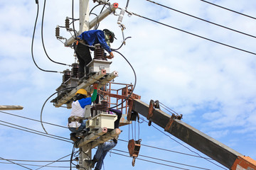 Technicians Working on Electrical Pole