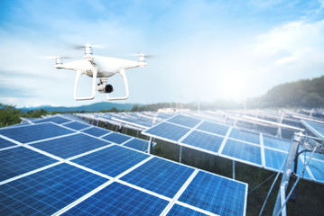 Drone with camera fly over Solar panels ; Photovoltaic systems . Wall mural