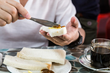 Series of person applying butter and kaya to steamed bread