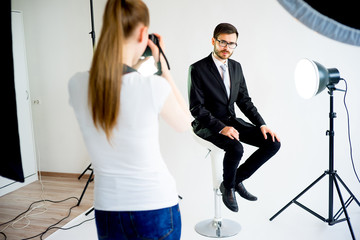 Photographer taking picture of a model in studio