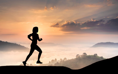 silhouette runner women exercise during morning time landscape background