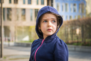 Blonde girl with hooded sweater, Munich, Bavaria, Germany