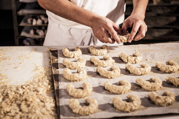 Confectioner making almond cookies