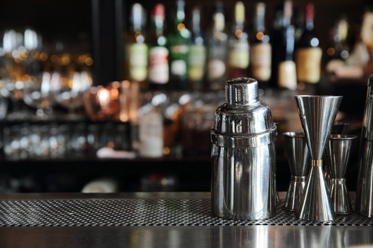 cocktail shaker on counter bar background