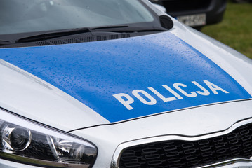 close up on Policja (Police) sign on car