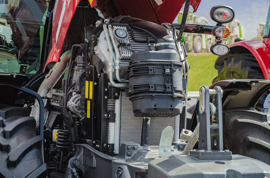 Powerful high-tech tractor engine in modern design, mounted on a frame with an open hood