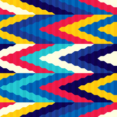 Seamless bright pattern of zigzags retro style. Contrasting colors. Ethnic style.