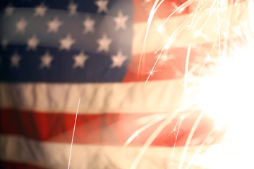Wall Mural - USA American flag lit up by sparklers for 4th of July celebrations