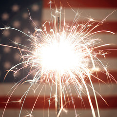 USA American flag lit up by sparklers for 4th of July celebrations