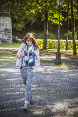 Young woman text messaging outdoors, Munich, Bavaria, Germany