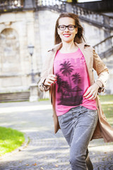 Young woman running outdoors, Munich, Bavaria, Germany