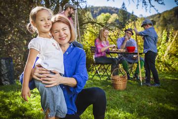 Multi-generation family in garden, Munich, Bavaria, Germany