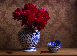 Still life with burgundy peonies in a chinese vase