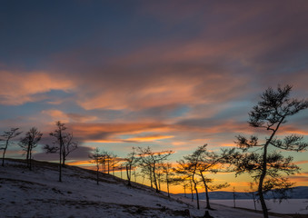 Multicolored dramatic cloudy sky just after sunset,cold winter, in beautiful Baikal lake, Siberia, Russia.