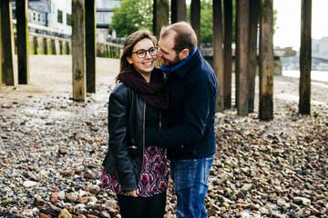 Couple embracing on coast