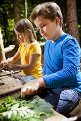 Children crafting in a forest camp, Munich, Bavaria, Germany