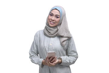 Attractive asian muslim woman holding smartphone