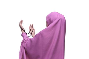 Pretty asian muslim woman wearing raising hand and praying