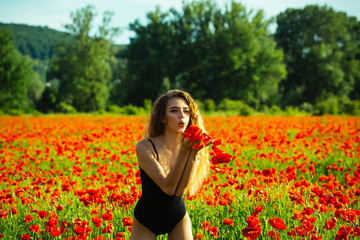 girl in field of poppy seed