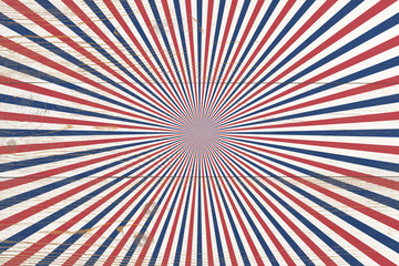 wooden planks painted with red and blue radial stripes