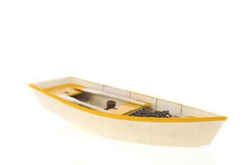 Wooden row boat isolated over white