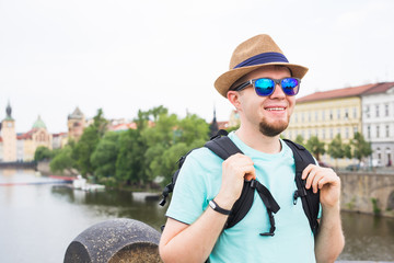 Portrait of a happy young man traveling with backpack