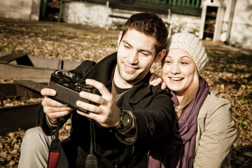 Young couple taking a self portrait outdoors