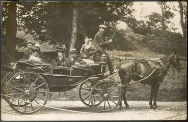 Family Carriage Outing. Date: early 20th century
