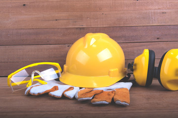 Standard construction safety,Safety equipment on wooden background with copy space