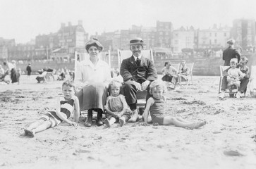 Family on Beach - circa 1920. Date: circa 1920