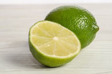 Juicy lime on wooden table