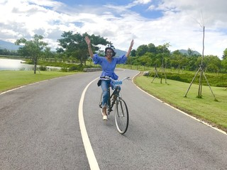 happy woman ride bicycle