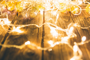 Christmas fairy lights on a wooden table