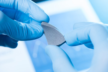 New material in scientist hands research concept