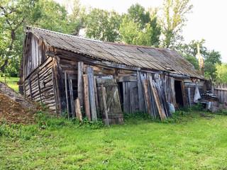 Old disturbed wooden barn. Bulatovo village, Kaluzhskaya region, Russia.