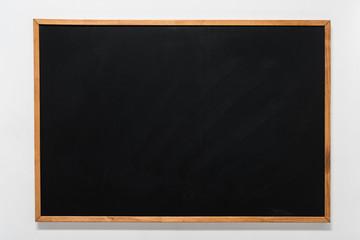 empty school blackboard in wooden frame with copy space