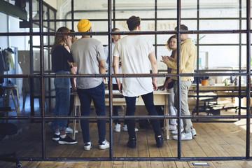 People in modern office having meeting
